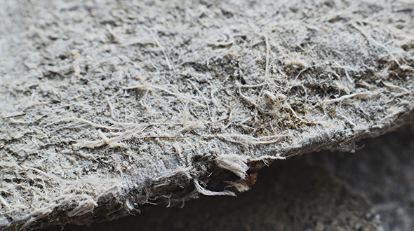 Asbestos materials used in roofing systems