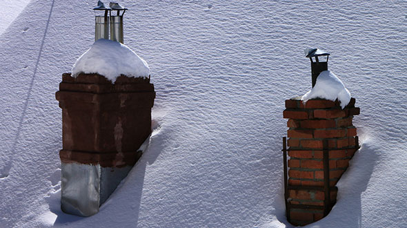 Ice dams formed by a poorly insulated chimney