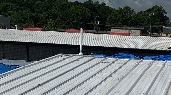 Commercial roofing metal panel roof