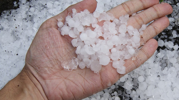 Commercial roofing system insurance claim damaged by hail storm