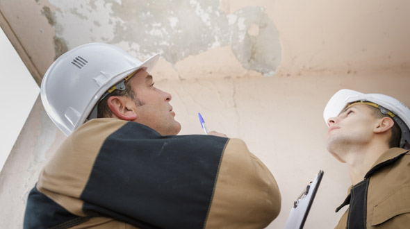 Leaky commercial roof inspection and evaluation