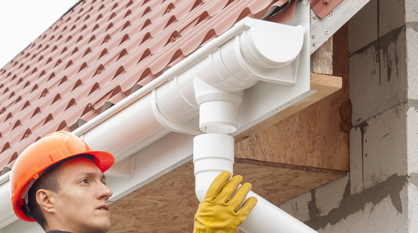 Commercial roofing rain gutter drainage system