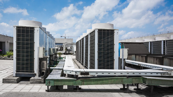 Commercial roofing system elevated walkway between air conditioning units