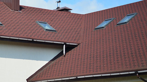 Shingles and tiles on a commercial sloped roof