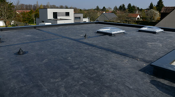 New EPDM single ply membrane roofing system installation