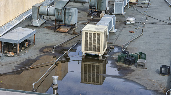 Equipment on commercial roof contributing to an impending collapse