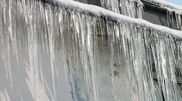 Commercial roofing damage from ice dams