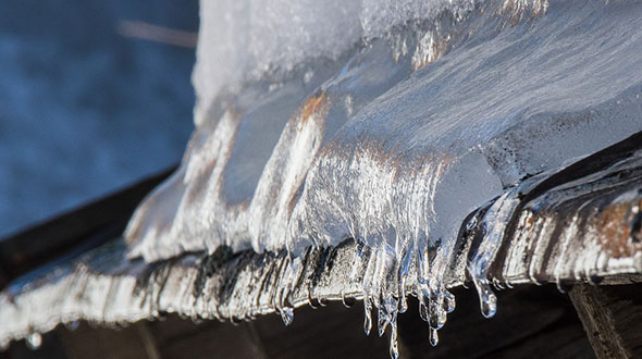Ice dams on commercial roofing in winter time