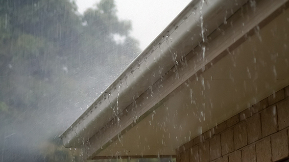 Stopping a roof leak in the rain can mean clearing your gutters so water can flow away from your roof