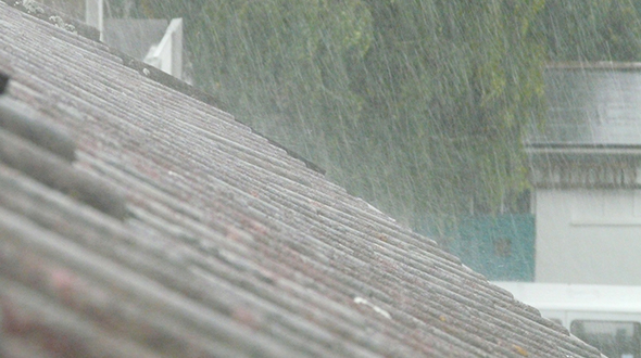 Stopping a roof leak in the rain requires some investigation and swift action