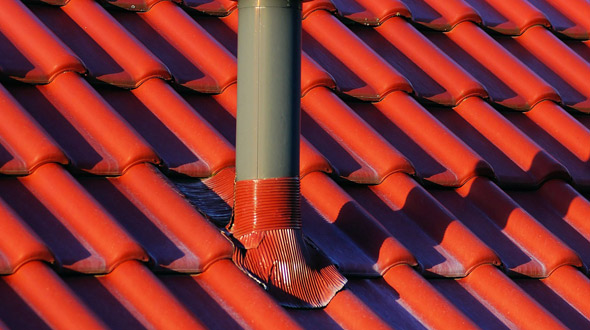 Commercial roof vent penetration with flashing