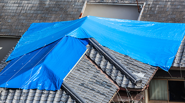 Stopping a roof leak in the rain may require you to tarp it until professional help can permanently fix it