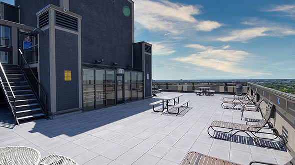 Commercial rooftop deck with lounging furniture and tables