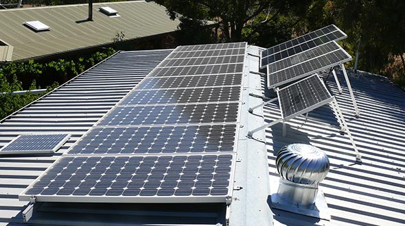 Solar panels installed on a commercial metal roofing system