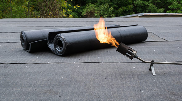 Commercial roof torch down modified bitumen installation